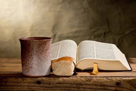 the passion of christ:  Bible chalice and bread