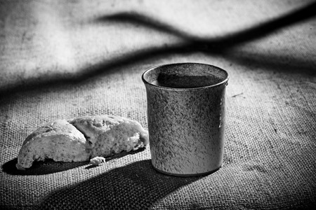 last supper:  chalice and bread on the textile tablecloth Stock Photo