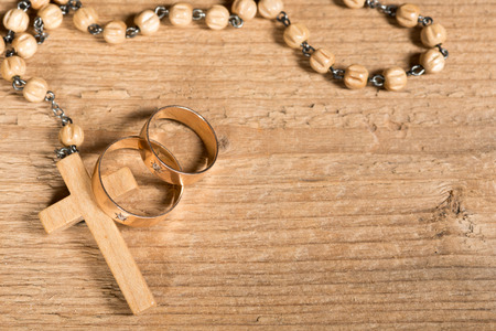 wedding rings and rosary