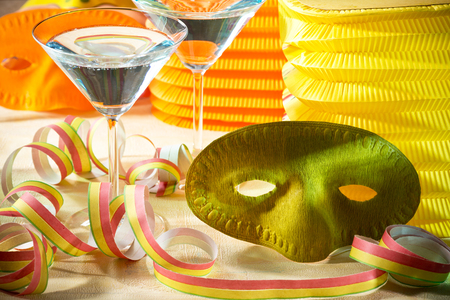 s eve: green carnival mask with wine glasses