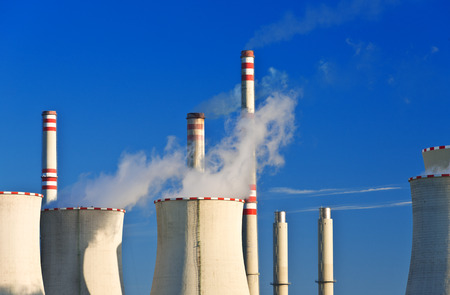 close up chimney: detail of power station with blue sky Stock Photo
