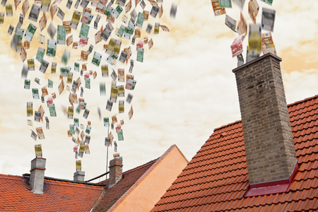 a lot of euros flies up the chimney Standard-Bild