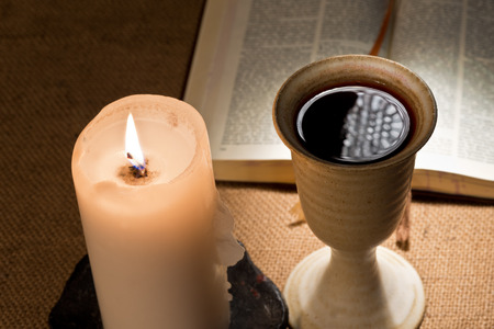 still life with bible and chalice ofwine  photo