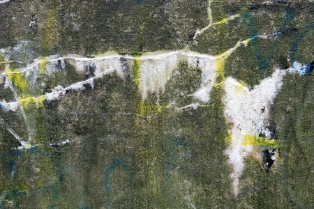 sodden: a old wall with graffiti  in the rain Stock Photo