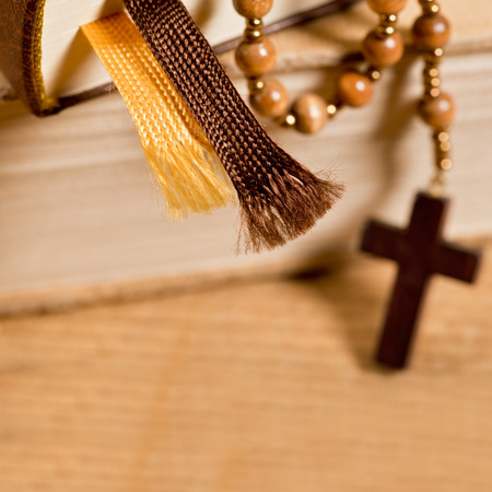 bible and old wooden rosary photo