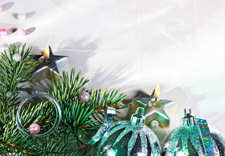 silver Christmas background with candle and needles photo