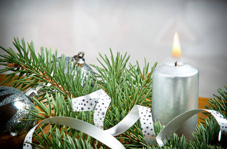 a Christmas candle with silver background photo