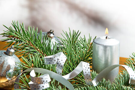Christmas candle with silver background photo
