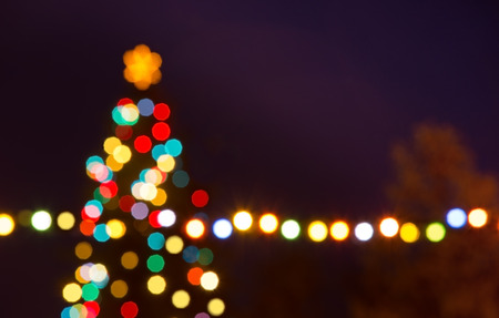 christmas time: Christmas tree with unfocused bauble in the night