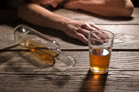 mope: drunk man with a glass of brandy in the pub Stock Photo