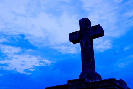 detail of cross on the blue sky photo