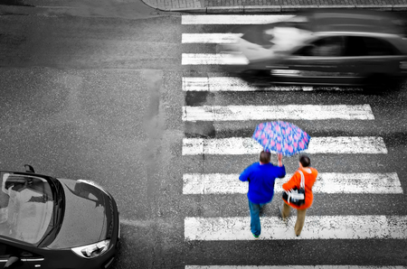 pedestrian crossing with cars in the rain photo