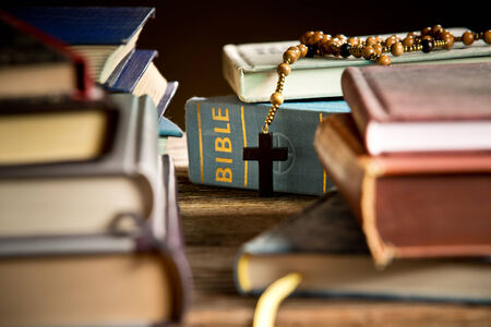 holy bibles: a bible and rosary in the bookcase