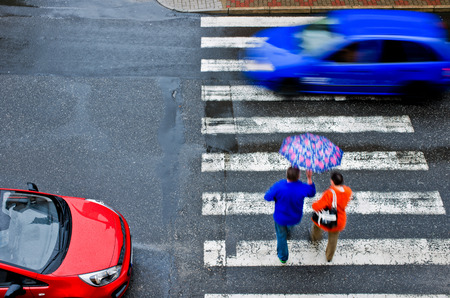 pedestrian crossing with car photo