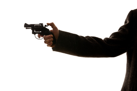 man shooting a handgun on the white background photo