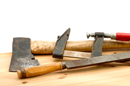 old used tools on the wooden desk photo