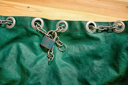 padlocked: padlock with chain on the old bag Stock Photo