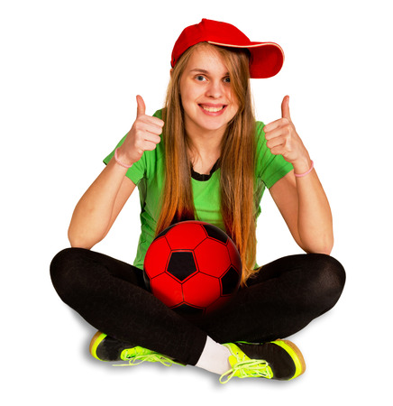 be dressed in: girl be sitting with ball on the white background Stock Photo