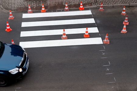 top down car: making of a new pedestrian crossing on the road