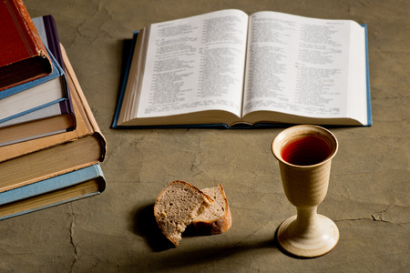 chalice bread: chalice of wine with bread and bible