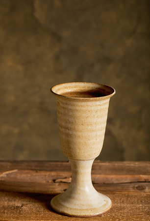 chalice bread: chalice of wine and bread on the dark background