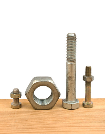 chromium plated: bolts and nuts on the wooden desk