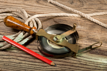 wooden metre: tape measure and old rope