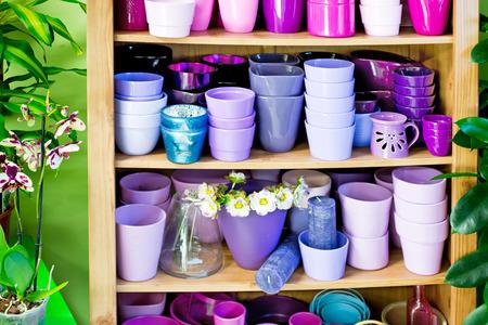 flowerpots: new violet flowerpots in a shelf in a market Stock Photo