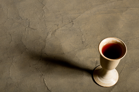 protestant: a chalice of wine with long shadow Stock Photo