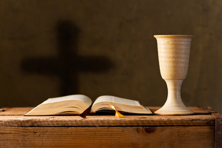 open bible with chalice of wine in the church,selective focus Banque d'images