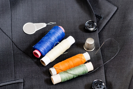 sewing kit: sewing kit on the gray mans jacket Stock Photo