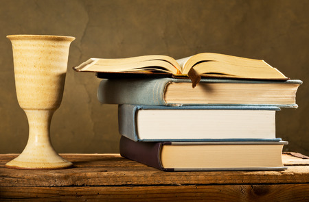 chalice: chalice of wine with bible and books