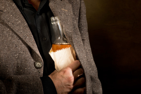 hard drinker with a bottle in the paper bag photo