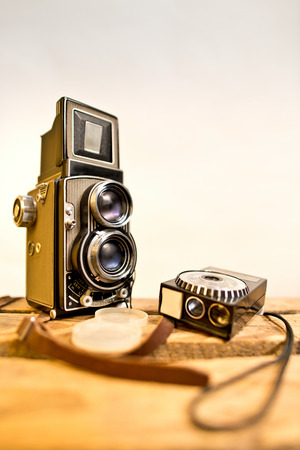 viewfinder vintage: old twinlens reflex camera with light meter on the white background Stock Photo