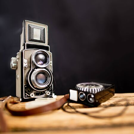 reflex camera: old twinlens reflex camera with light meter on the black background Stock Photo