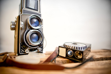 reflex camera: old twinlens reflex camera with light meter on the white background Stock Photo