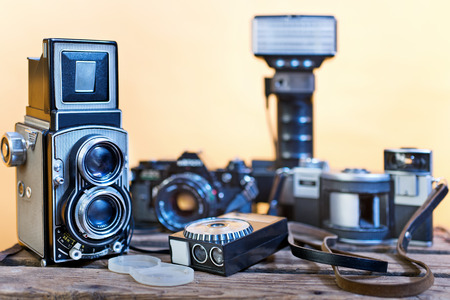 analogue: old analogue photographic cameras on the white background