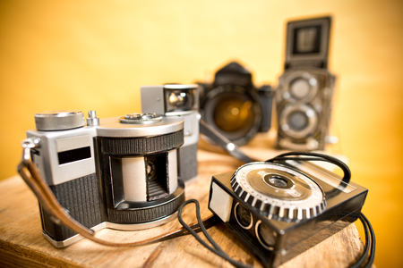analogue: old analogue photographic cameras on the yellow
