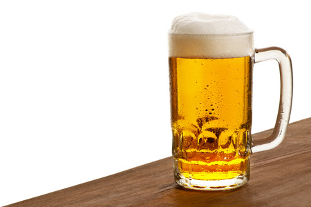 on tap: a beer glass on the white background Stock Photo