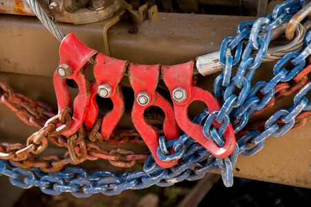 mechanical works: a detail of winch trucks witch chains Stock Photo