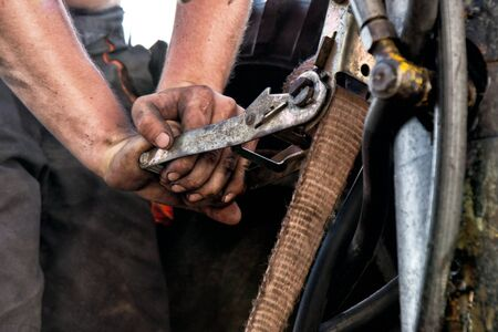 unskilled worker: a detail of hands of dirty worker