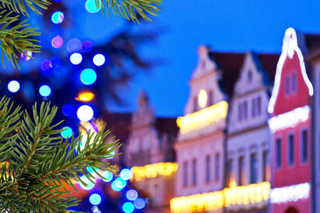 christmas in the city: buildings with christmas decoration and christmas tree