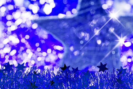 blurr: blue christmas background with star and glitter