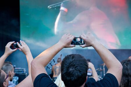 man make a video from a rock concert in atec Hops and Beer Festival