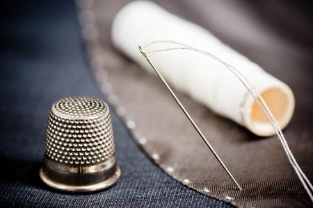 n�hzeug: sewing kit on the gray mans jacket Lizenzfreie Bilder