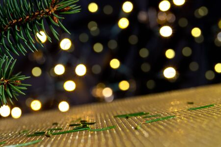 golde: Christmas background with needles and color lights