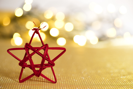 golde: Red Christmas star on the unfocused background