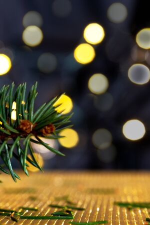golde: Christmas background with needles and color llights