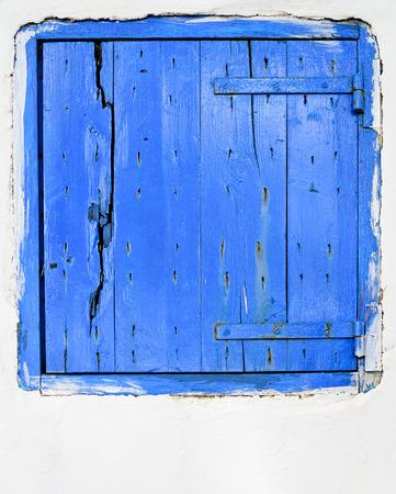 wicket door: blue wooden small door, taken in Greece