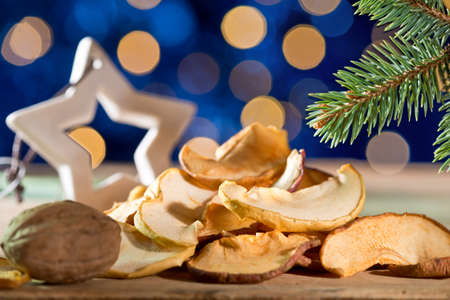 dry fruit: Dry fruit with christmas star on the blue background on the Christmas table